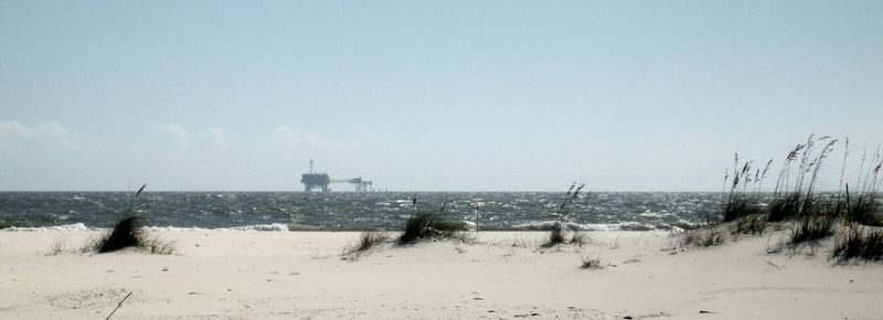 Sand dunes on the Gulf and a lovely oil rig in the background