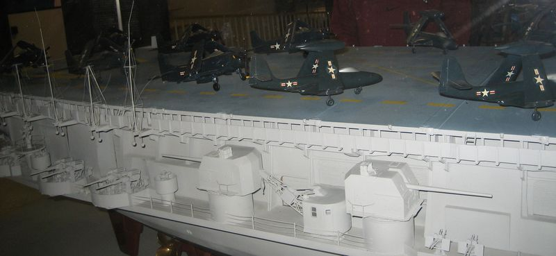 Tiny models of Navy fighter jets at the back of the carrier
