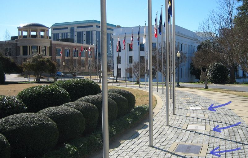 All the state flags had plaques at the base of the flagpole identifying each state