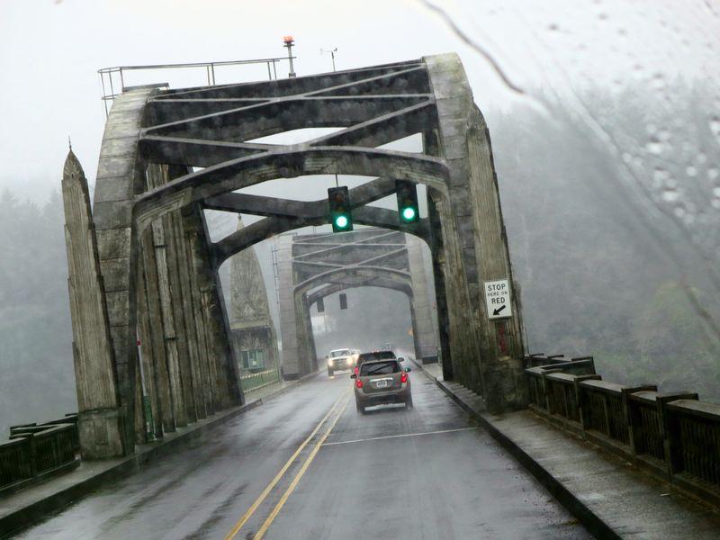 Bridge in the fog and rain