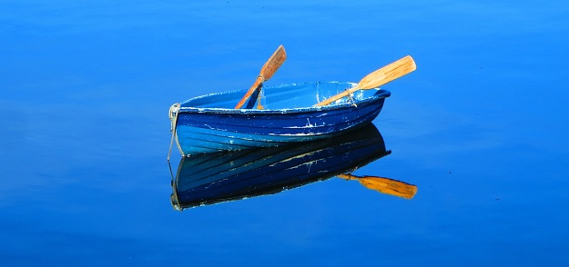Blue rowboat in the blue water