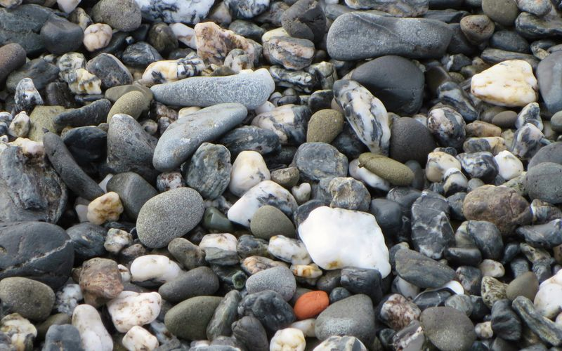 Beach rocks washed in with the tide