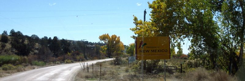 New Mexico welcome sign thru a DIRTY windshield