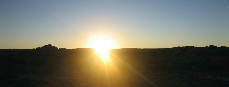 Sun heading behind the hills as we enter Albuquerque