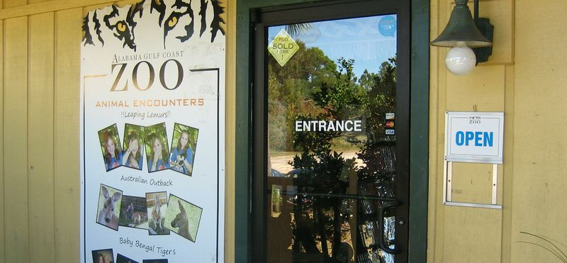 Zoo front door with a strange sign in the window